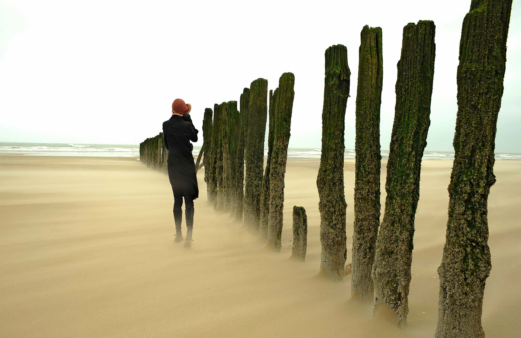 """""""A Maddening Disregard for the Passage of Time""""  The beach in Calais. It was a freezing cold day in January and we were only 2 souls on that beach.  Us and a wind of over 80 mph."""